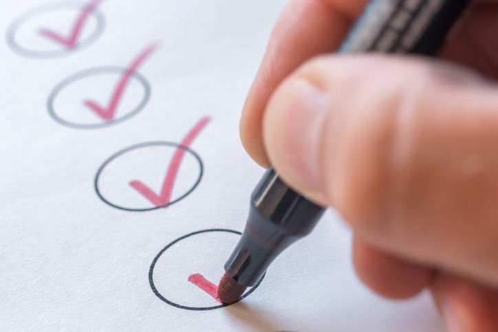 person checking boxes on a checklist