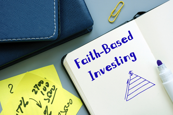 Faith Based Investing written on notebook