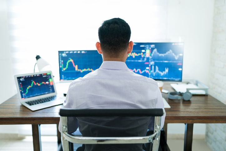 gentleman looking at stocks on computer