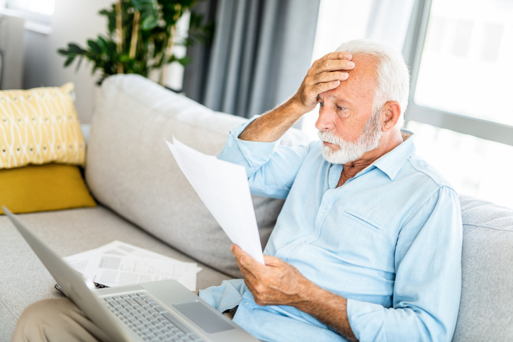 older gentleman worried over retirement documents