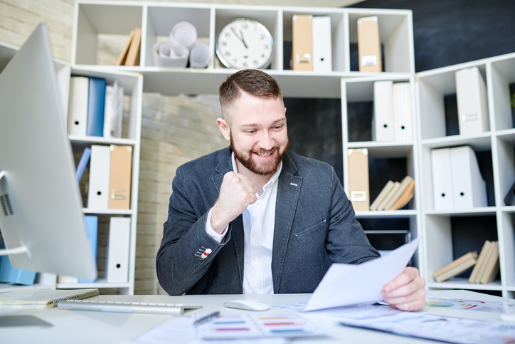 man in office reviewing paperwork