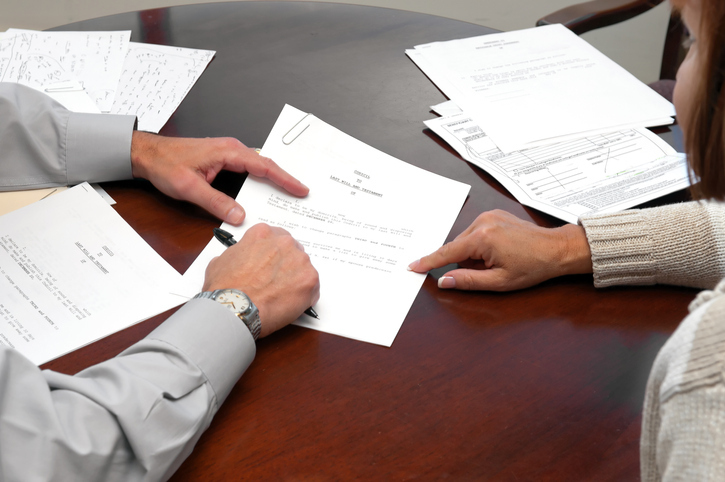 man and woman reviewing paperwork at table